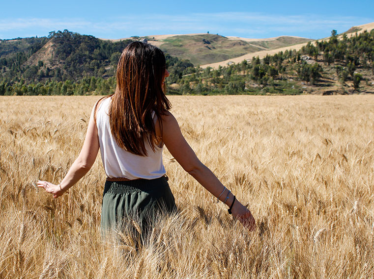 Girl in a durum wheat field